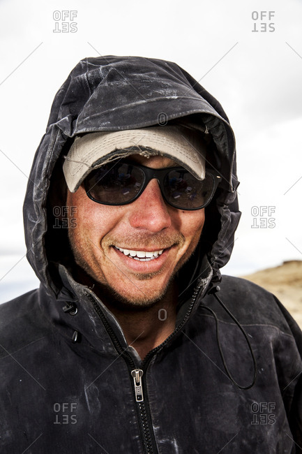 New Mexico - May 17, 2016: Paleontologist smiling in hooded coat