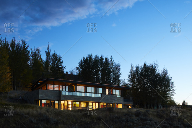 Mountainside home illuminated at night in Wyoming