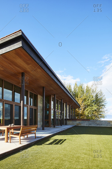 Jackson, Wyoming - October 1, 2016: Modern home with covered patio and wooden outdoor furniture
