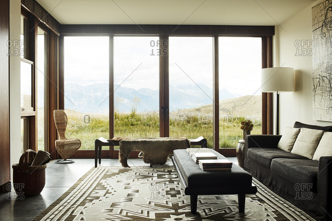 Jackson, Wyoming - October 1, 2016: Living room with a southwestern style rug and a mountain view