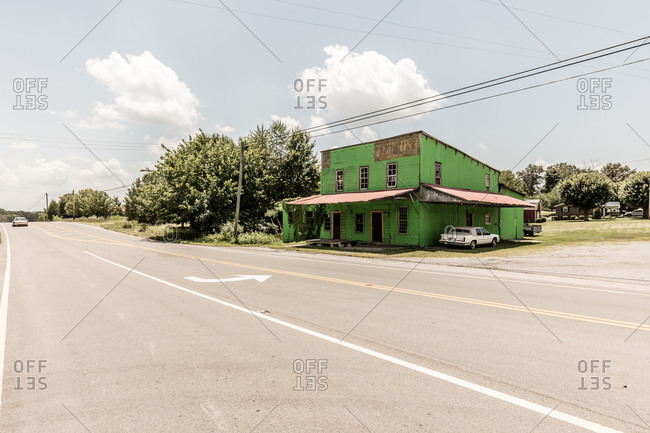 Centertown, Tennessee - July 13, 2015: Old green building on the side of a road in Centertown, Tennessee