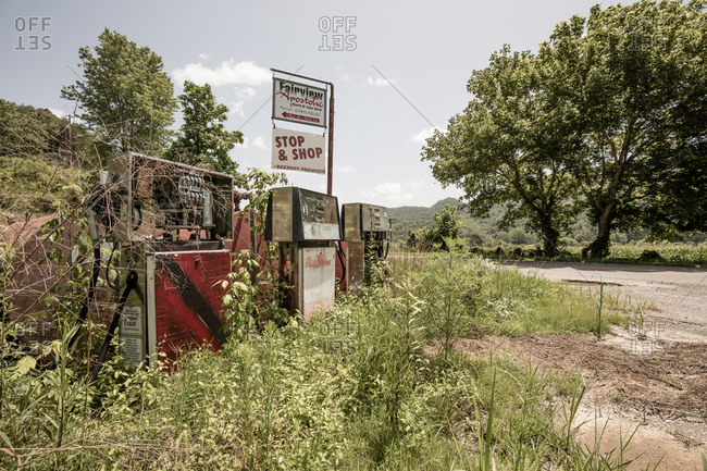 Blackwater, Virginia - July 10, 2015: Church sign behind old gas pumps