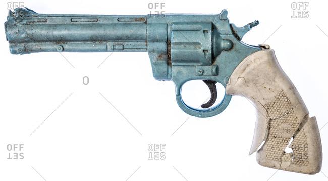 Macedonia - February 29, 2016: Broken toy gun on a white background