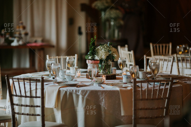 Tables set with traditional China and tea cups for a wedding reception