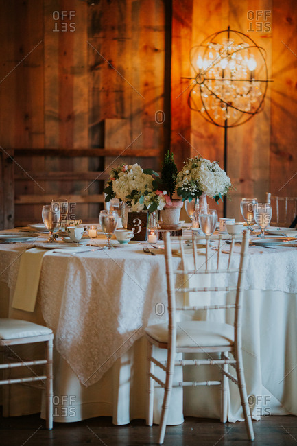Table settings in a rustic wooden room with lighting