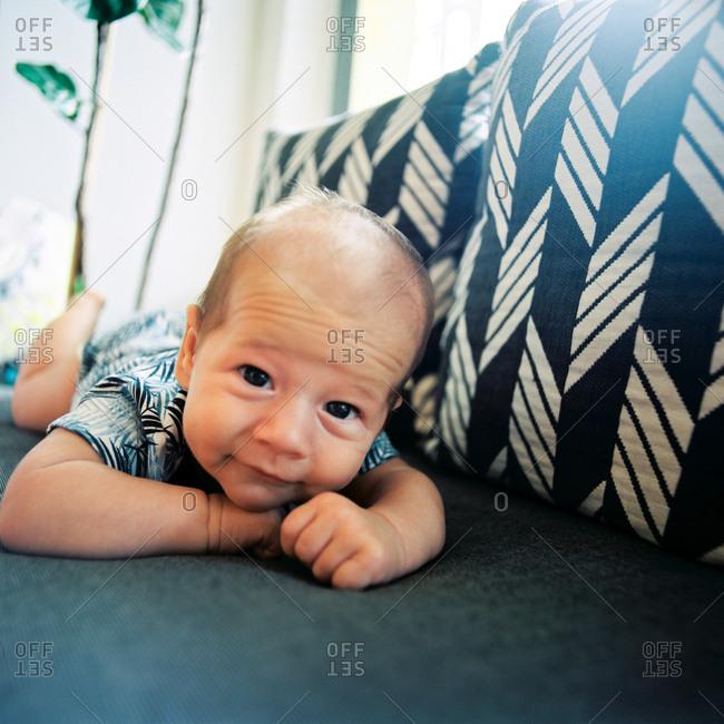 Cute infant boy lying on tummy
