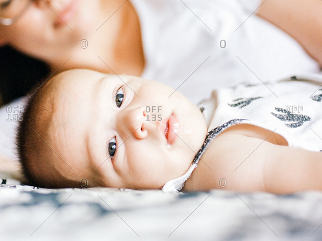 Close-up portrait of infant boy lying on his back