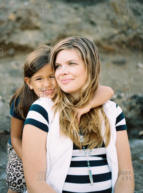 Daughter hugging her pregnant mother