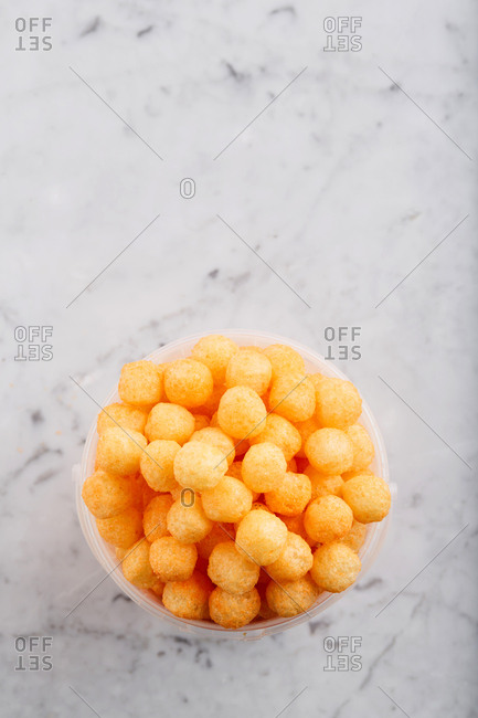 Dry puffed grain cereal balls