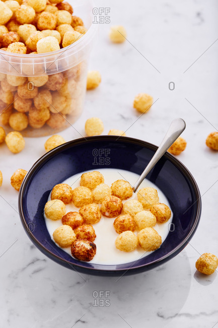 Bowl with milk and puffed grain cereal