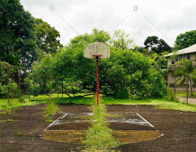 An abandoned outdoor basketball court