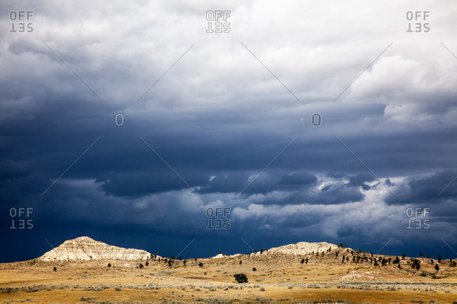 Stormy clouds over remote peaks