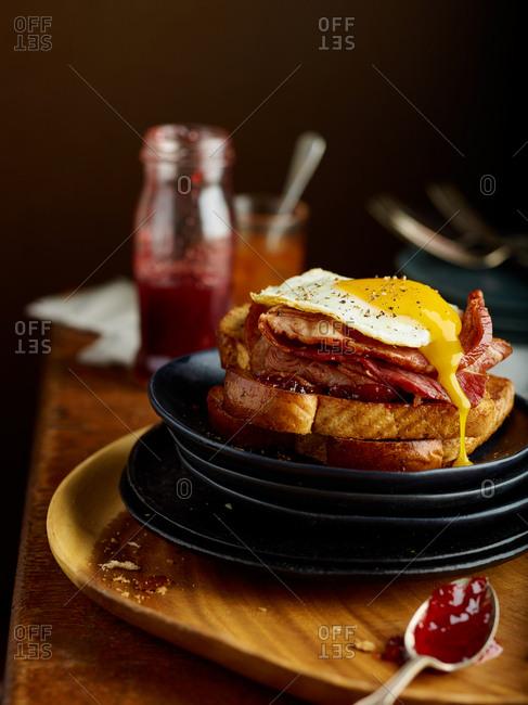 Egg yolk running over ham and bread