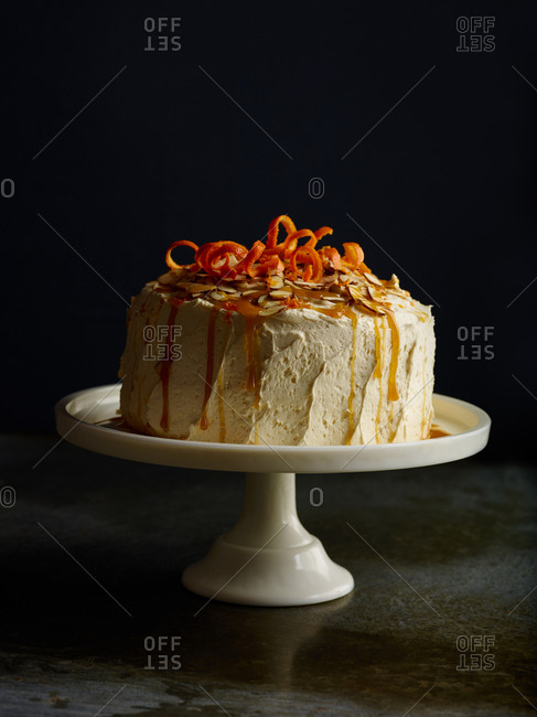 Cake topped with citrus and almonds