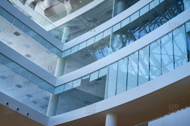 Close-up view of glass walls in modern multi-storied office building
