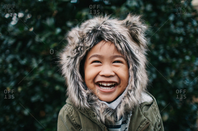 Laughing boy with furry hood