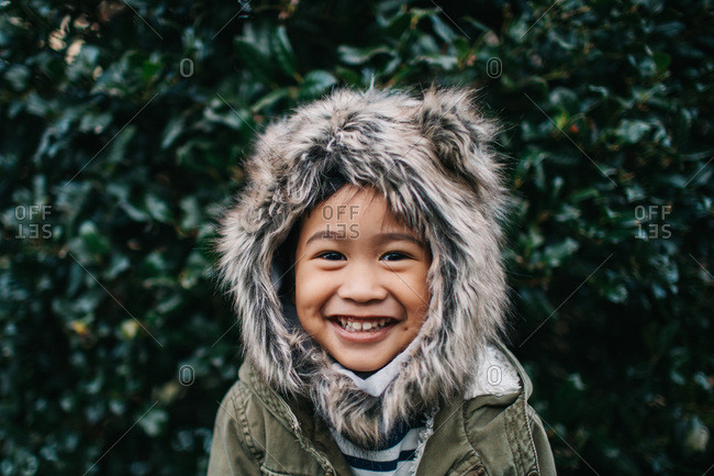 Grinning boy with furry hood
