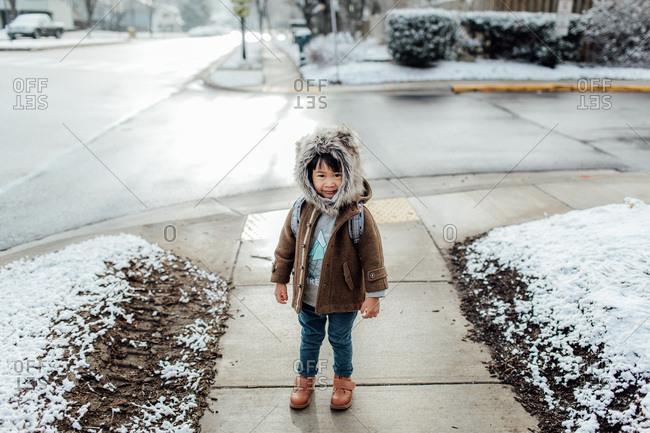Boy going to school in fur hood
