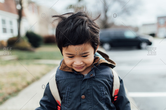 A boy wearing backpack outside
