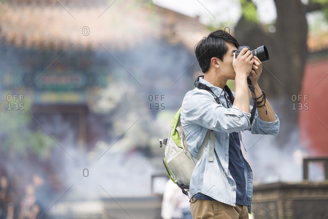 Young man taking pictures in the Lama Temple