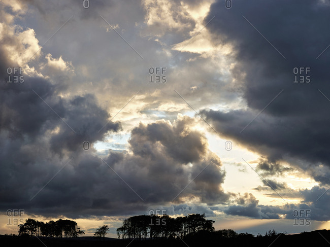 Dramatic sunlight and cloud formation in rural Swansea, Wales
