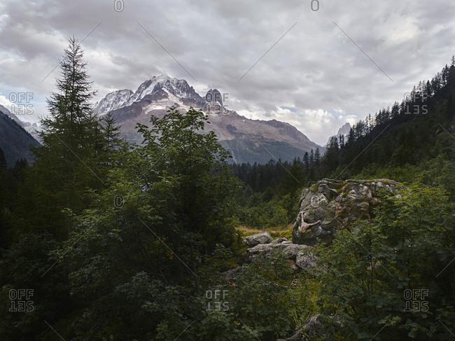 Man climbing a boulder in Chamonix, France