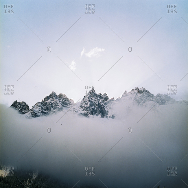 Craggy mountains above fog line