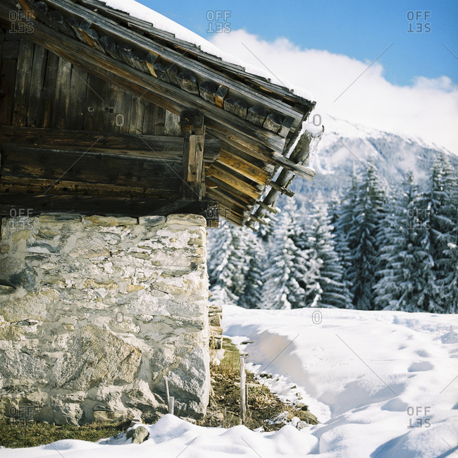 Rustic stone building in snowy landscape