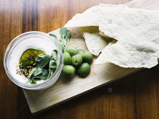 Labneh snack on wooden board