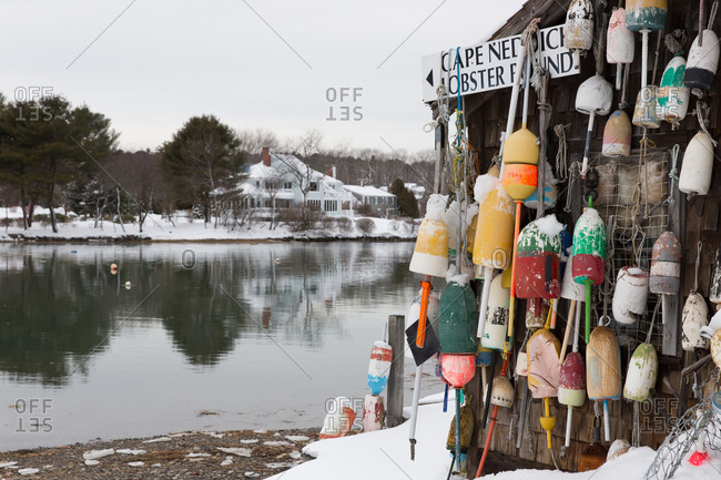 Cape Neddick, Maine, USA - February 14, 2017: Building covered in net and buoys on the coast of Maine in winter