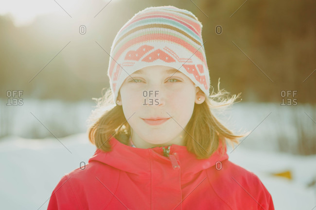 Portrait of a girl wearing knit hat with lens flare