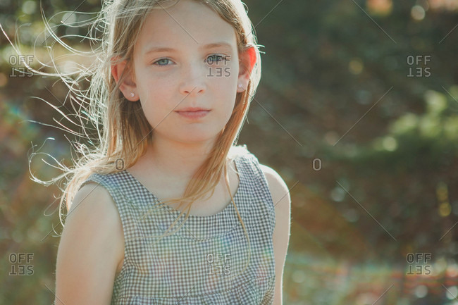 Portrait of a blonde girl with lens flare