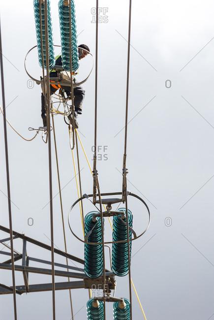 Guadalajara, Spain - March 4, 2008: Man working in an electricity structure in Slato Bolarque dam, Spain