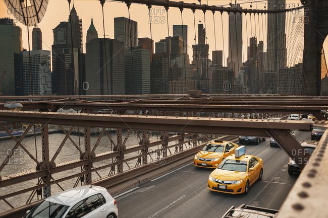 Traffic on bridge, urban skyline in background