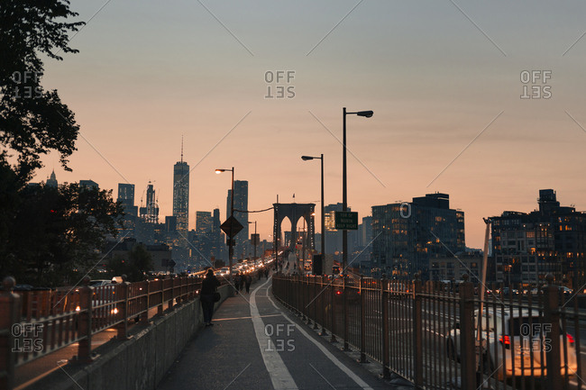 USA, New York - May 13, 2016: Skyscrapers and bridge in downtown district at sunset
