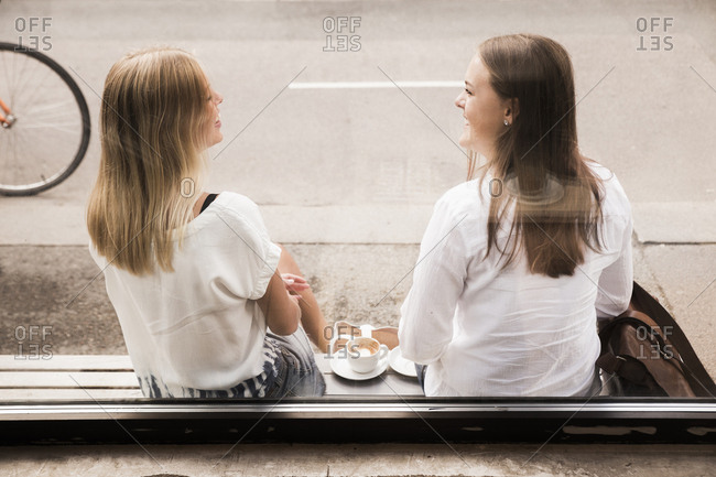 Young women talking outside of cafe