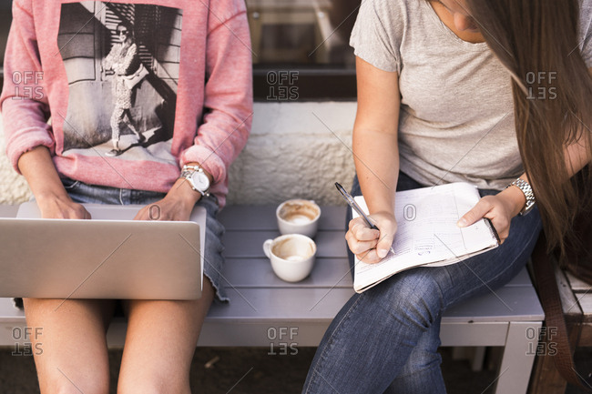 Young women studying and using laptop