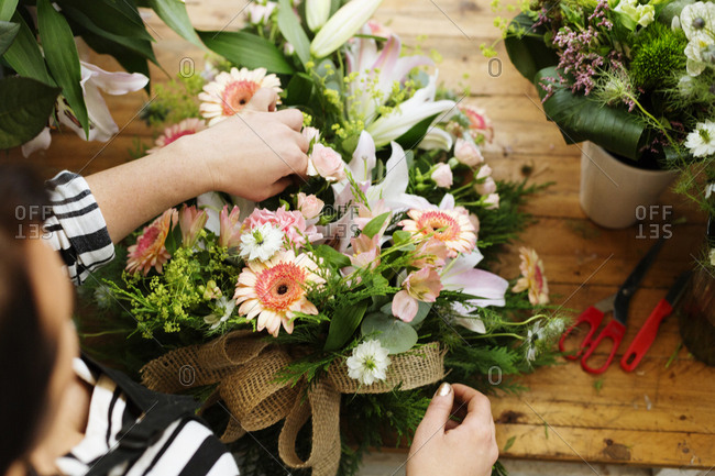 Florist making flower bouquet