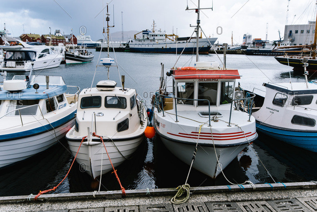 Torshavn, Faroe Islands - May 16, 2015: Boats tied to a mooring in Torshavn harbor
