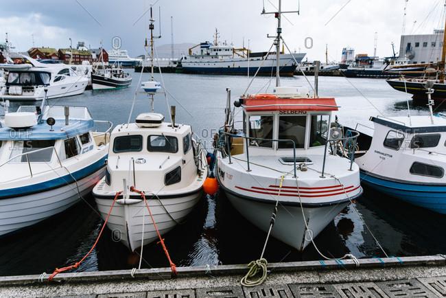 Torshavn, Faroe Islands - May 16, 2015: Boats tied to a mooring in Torshavn harbor