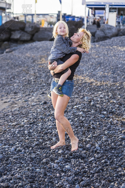 Woman with son on rocky beach