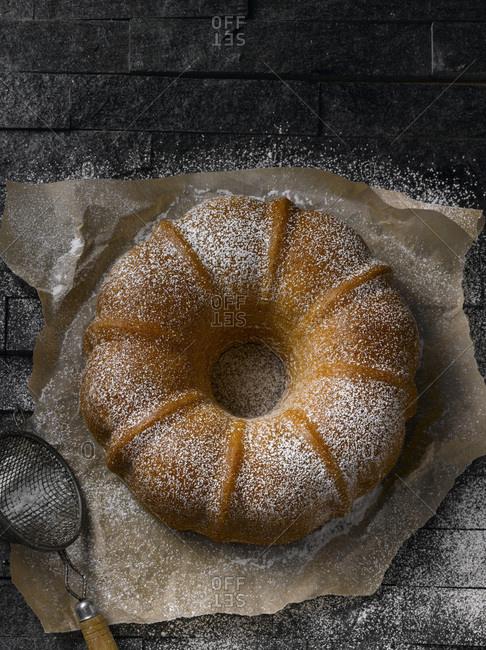 Powdered round pound cake shot from above