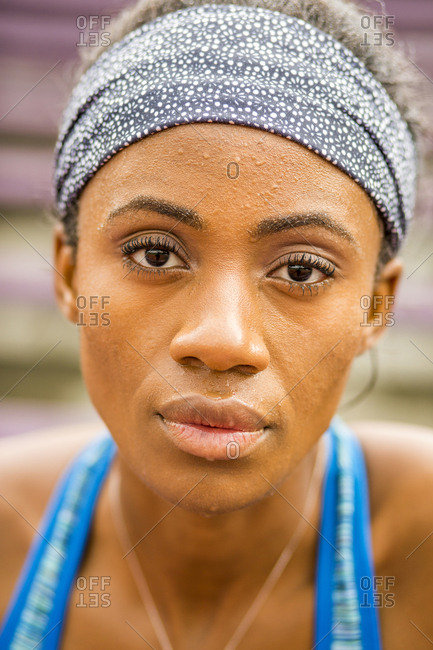 Serious Black woman sweating