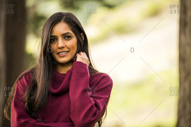 Portrait of smiling Indian woman wearing sweater