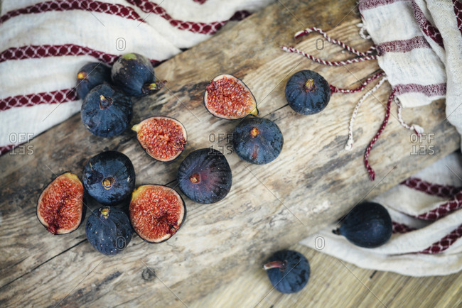 Sliced figs on wooden log