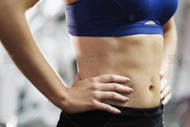 Sweating midriff of Mixed Race woman