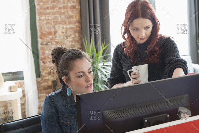 Caucasian businesswomen using computer in office