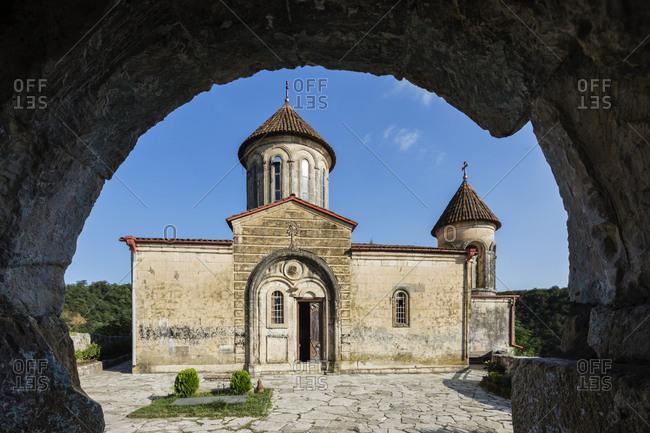 Stone arch framing monastery, Kutaisi, Imereti Region, Georgia