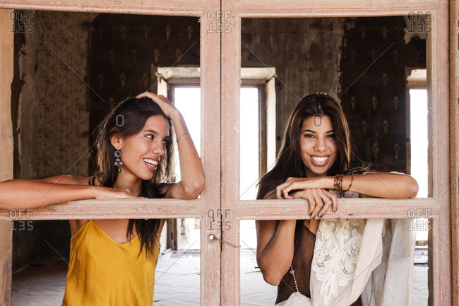 Brunette women leaning on windowless doors