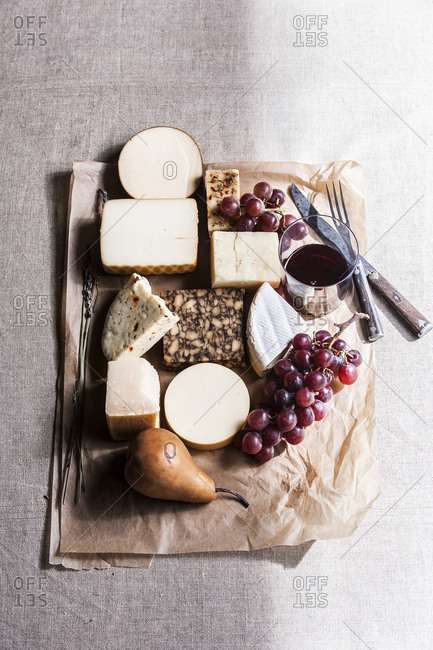 Assorted cheese and fruit with wine
